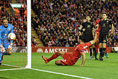 Emre Can of Liverpool scores a goal to level the scores at 11 during the UEFA Europa League Group B match between Liverpool FC and Rubin Kazan at...