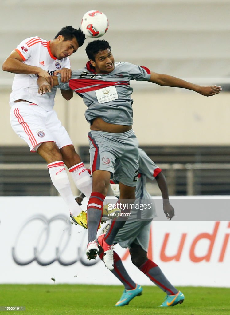 <a gi-track='captionPersonalityLinkClicked' href=/galleries/search?phrase=Emre+Can&family=editorial&specificpeople=5909273 ng-click='$event.stopPropagation()'>Emre Can</a> (L) of Muenchen jumps for a header with Issiar Dia of Lekhwiya during the international friendly match between Lekhwiya Sports Club and FC Bayern Muenchen at Khalifa International Stadium on January 5, 2013 in Doha, Qatar.