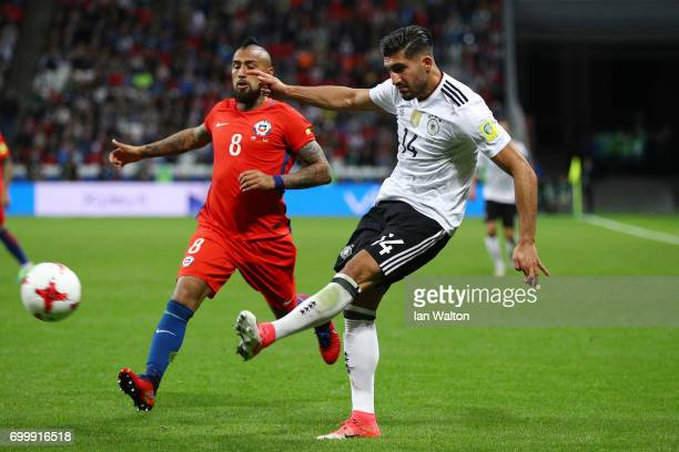 Emre Can ofGermany crosses the ball while under pressure from Arturo Vidal of Chile during the FIFA Confederations Cup Russia 2017 Group B match...
