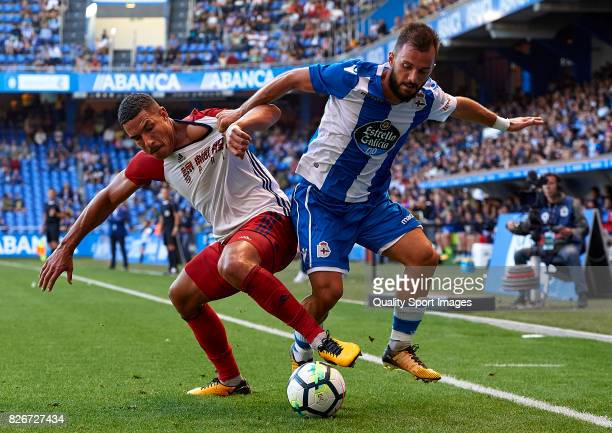 Emre Colak of Deportivo de La Coruna is challenged by Jake Livermore of West Bromwich Albion during the Pre Season Friendly match between Deportivo...