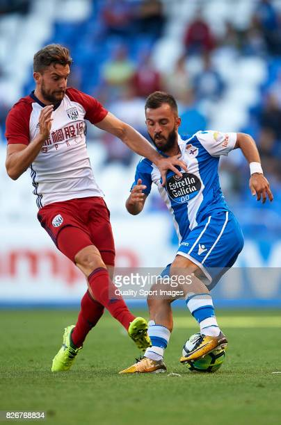 Emre Colak of Deportivo de La Coruna is challenged by Jay Rodriguez of West Bromwich Albion during the Pre Season Friendly match between Deportivo de...