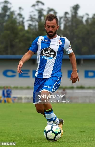 Emre Colak of Deportivo de La Coruna runs with the ball during the preseason friendly match between Cerceda and Deportivo de La Coruna at O Roxo...