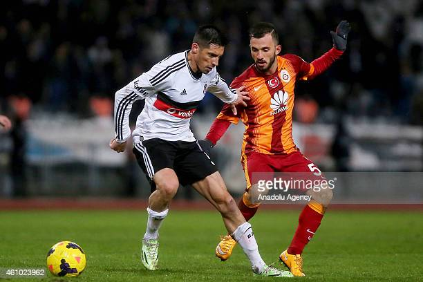 Emre Colak of Galatasaray vies for the ball during the Turkish Spor Toto Super League soccer match between Besiktas and Galatasaray at Ataturk...