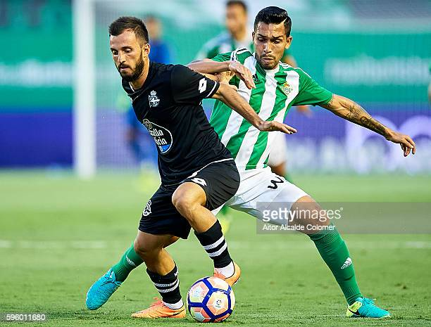 Emre Colak of RC Deportivo La Coruna competes for the ball with Petros Matheus dos Santos of Real Betis Balompie being followed by during the match...