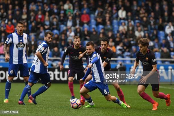 Emre Colak of RC Deportivo La Coruna competes for the ball with Sergio Busquets of FC Barcelona during the La Liga match between RC Deportivo La...