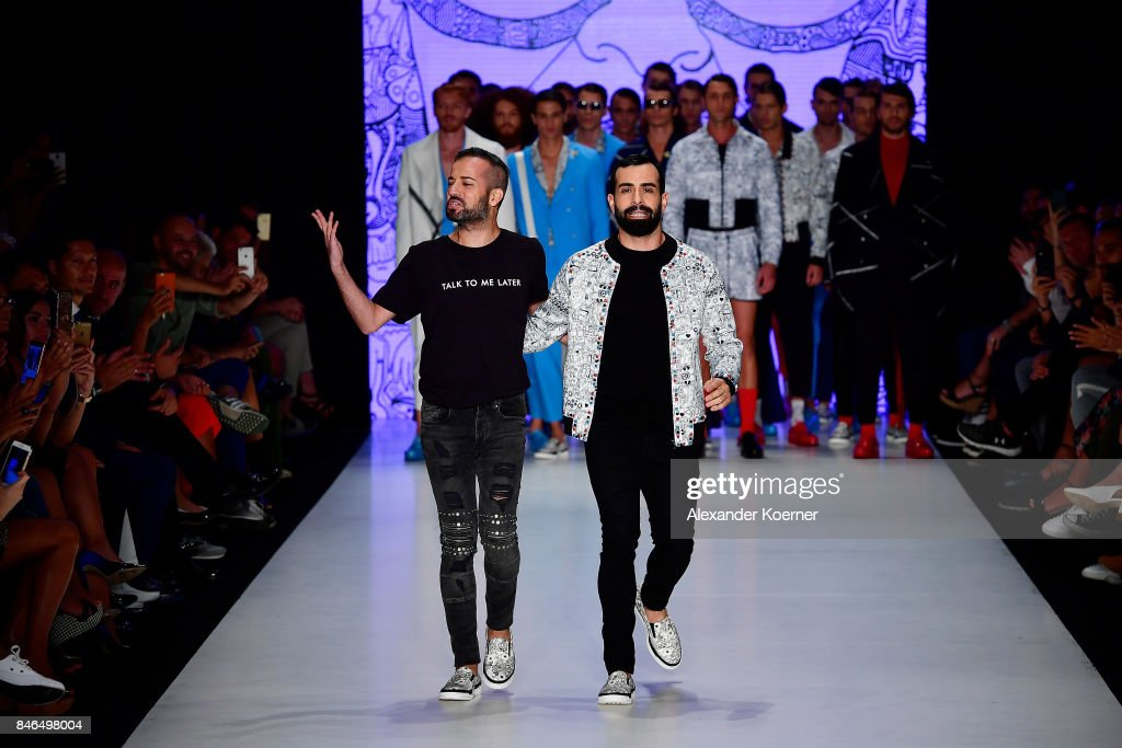 Emre Erdemoglu (L) and Gokhan Turkmen walk the runway at the Emre Erdemoglu show during Mercedes-Benz Istanbul Fashion Week September 2017 at Zorlu Center on September 13, 2017 in Istanbul, Turkey.