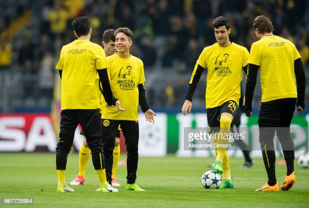 Emre Mor and Mikel Merino of Borussia Dortmund wearing the designed shirt for Marc Bartra prior to the UEFA Champions League Quarter Final First Leg...