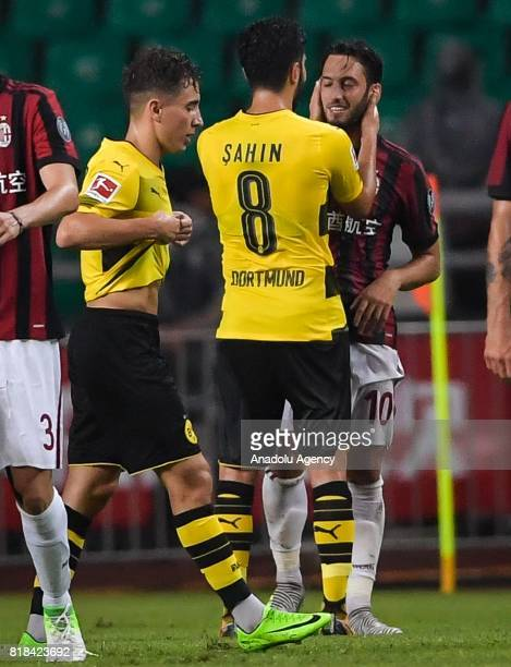 Emre Mor and Nuri Sahin of Borussia Dortmund talk with Hakan Calhanoglu of AC Milan during the 2017 International Champions Cup football match...