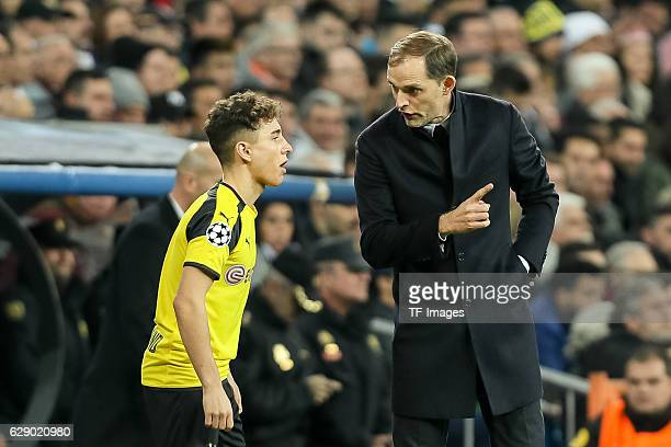 Emre Mor of Borussia Dortmund and coach Thomas Tuchel of Borussia Dortmund gestures during the UEFA Champions League match between Real Madrid CF and...