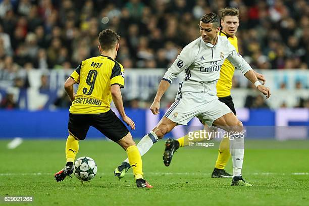 Emre Mor of Borussia Dortmund and Cristiano Ronaldo of Real Madrid battle for the ball during the UEFA Champions League match between Real Madrid CF...