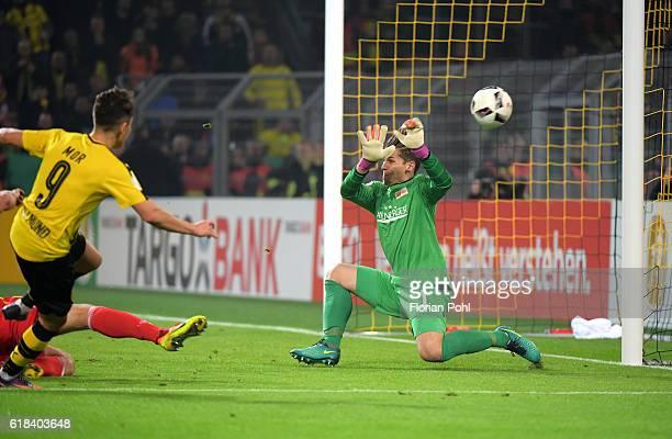 Emre Mor of Borussia Dortmund and Daniel Mesenhoeler of 1FC Union Berlin during the game between Borussia Dortmund and dem 1 FC Union Berlin on...