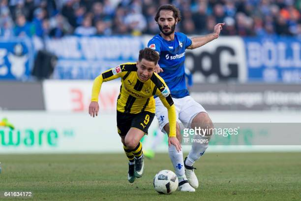 Emre Mor of Borussia Dortmund and Hamit Altintop of SV Darmstadt battle for the ball during the Bundesliga match between SV Darmstadt 98 and Borussia...