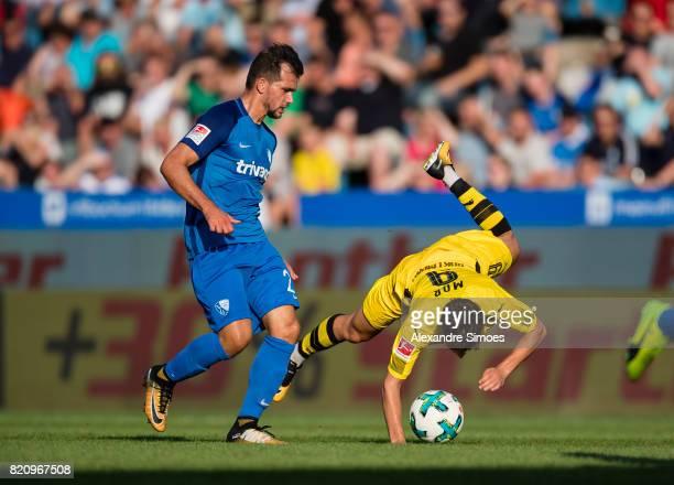 Emre Mor of Borussia Dortmund and Kevin Stoeger during the preseason friendly match between VfL Bochum and Borussia Dortmund at Rewirpower Stadium on...