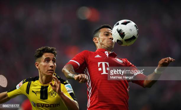 Emre Mor of Borussia Dortmund and Thiago Alcantara of Bayern Muenchen battle for possession during the Bundesliga match between Bayern Muenchen and...