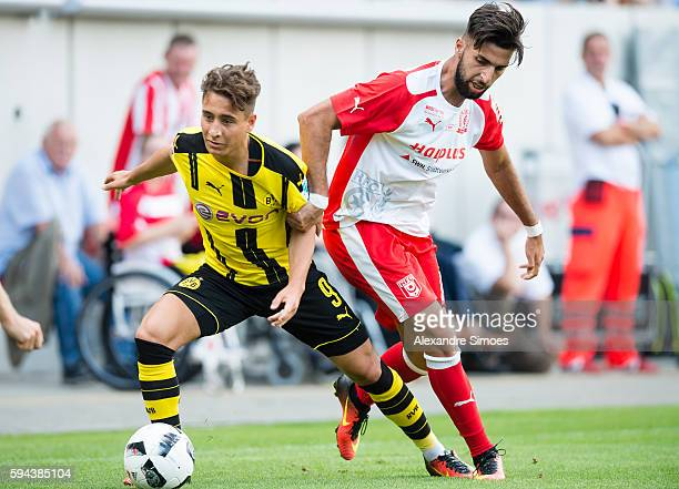 Emre Mor of Borussia Dortmund challenges Hilal ElHelwe of Hallescher FC during the friendly match between Hallescher FC and Borussia Dortmund at...