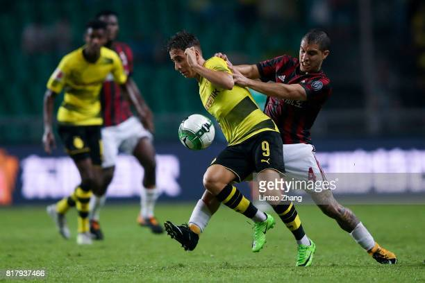 Emre Mor of Borussia Dortmund competes for the ball with Jose Mauri of AC Milan during the 2017 International Champions Cup football match between AC...