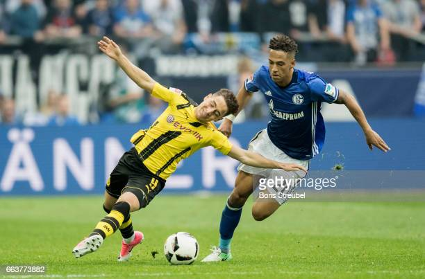 Emre Mor of Borussia Dortmund is challenged by Thilo Kehrer of FC Schalke 04 during the Bundesliga match between FC Schalke 04 and Borussia Dortmund...