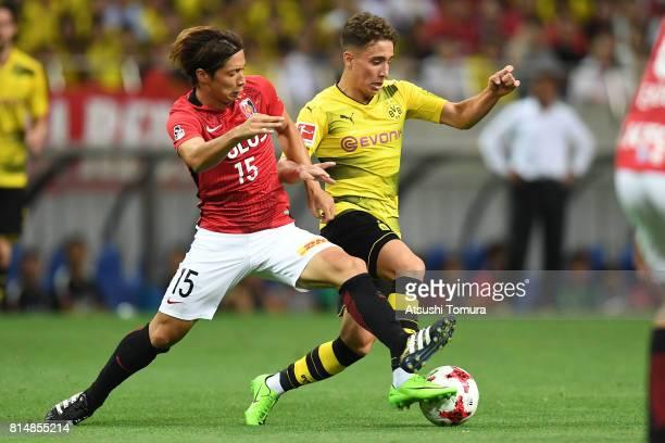 Emre Mor of Borussia Dortmund runs with the ball during the preseason friendly match between Urawa Red Diamonds and Borussia Dortmund at Saitama...