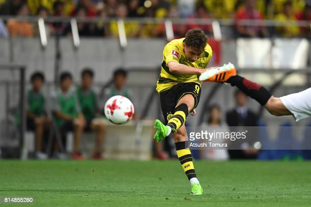 Emre Mor of Borussia Dortmund takes a shot during the preseason friendly match between Urawa Red Diamonds and Borussia Dortmund at Saitama Stadium on...