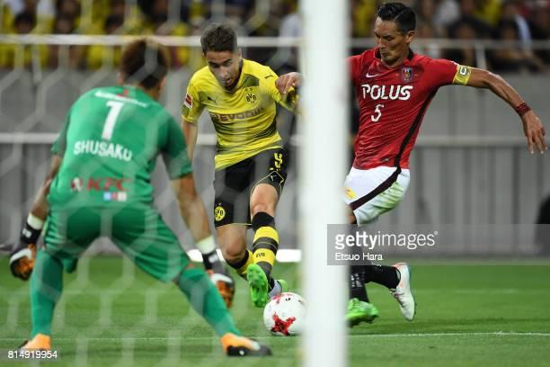 Emre Mor of Burussia Dortmund scores his side's first goal during the preseason friendly match between Urawa Red Diamonds and Borussia Dortmund at...