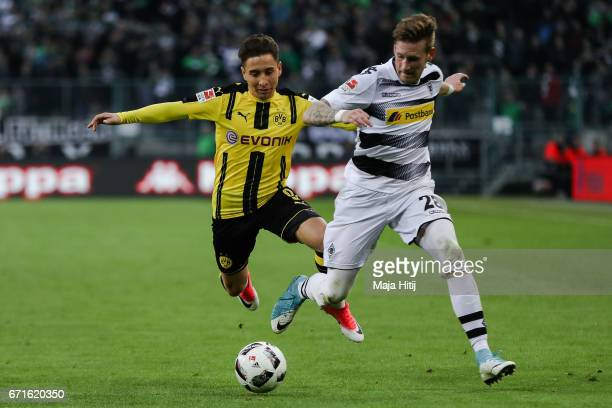 Emre Mor of Dortmund and Andre Hahn of Moenchengladbach battle for the ball during the Bundesliga match between Borussia Moenchengladbach and...