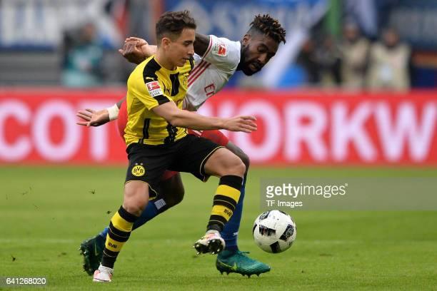 Emre Mor of Dortmund and Gideon Jung of Hamburg battle for the ball during the Bundesliga match between Hamburger SV and Borussia Dortmund at...