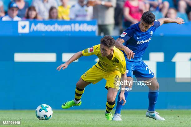 Emre Mor of Dortmund and Goerkem Saglam of Bochum battle for the ball during the preseason friendly match between VfL Bochum and Borussia Dortmund at...