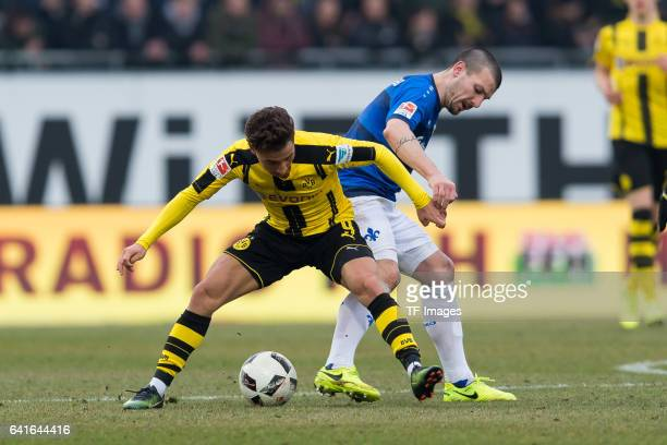 Emre Mor of Dortmund and Jerome Gondorf of Darmstadt battle for the ball during the Bundesliga match between SV Darmstadt 98 and Borussia Dortmund at...