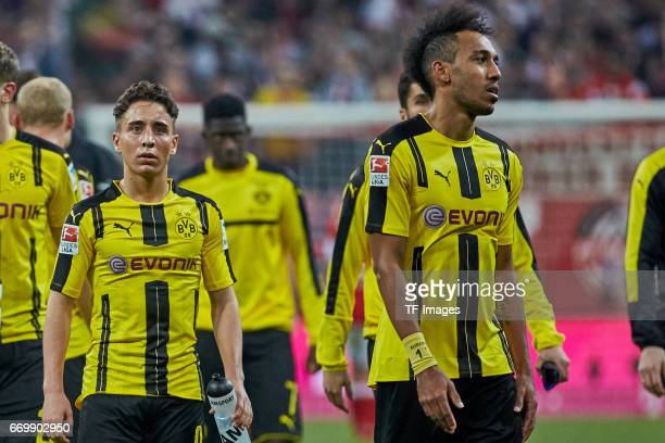 Emre Mor of Dortmund and PierreEmerick Aubameyang of Dortmund looks dejected during the Bundesliga match between Bayern Muenchen and Borussia...