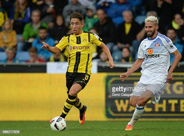 Emre Mor of Dortmund challenges Fabio Borini of Sunderland during the friendly match between AFC Sunderland v Borussia Dortmund at Cashpoint Arena on...