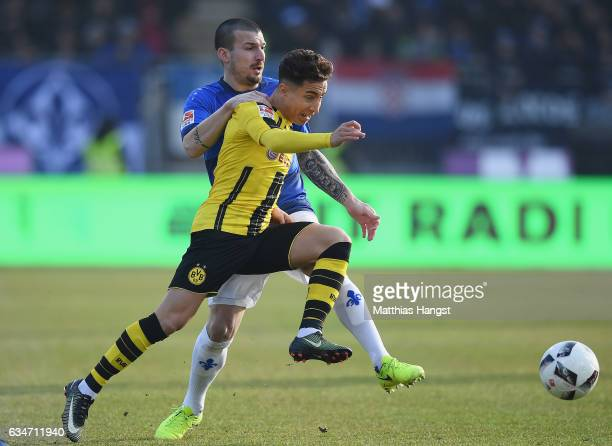 Emre Mor of Dortmund is challenged by Jerome Gondorf of Darmstadt during the Bundesliga match between SV Darmstadt 98 and Borussia Dortmund at...