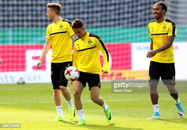 Emre Mor of Dortmund kicks the ball whilst Marco Reus and PierreEmerick Aubameyang looks on during the final training session one day before the DFB...