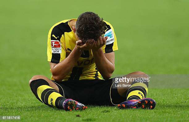 Emre Mor of Dortmund sits on the pitch during the Bundesliga match between Bayer 04 Leverkusen and Borussia Dortmund at BayArena on October 1 2016 in...