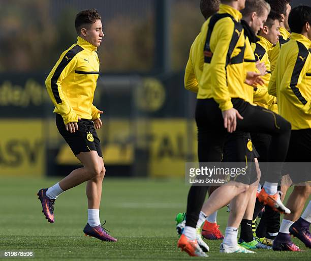 Emre Mor of Dortmund warms up during a training session ahead of their Champions League match against Sporting CP at Dortmund Brackel Training Ground...