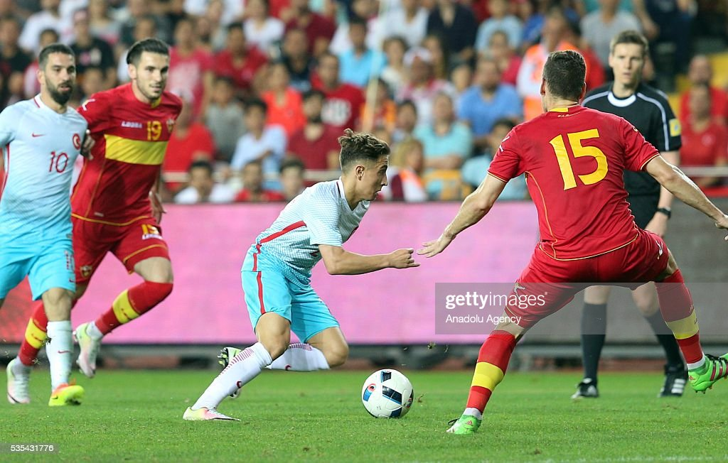 Emre Mor (C) of Turkey and Nemanja Mijuskovc (R) of Montenegro vie for the ball during the friendly football match between Turkey and Montenegro at Antalya Ataturk Stadium in Antalya, Turkey on May 29, 2016.