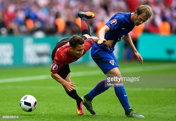 Emre Mor of Turkey is challenged by Ivan Strinic of Croatia during the UEFA EURO 2016 Group D match between Turkey and Croatia at Parc des Princes on...