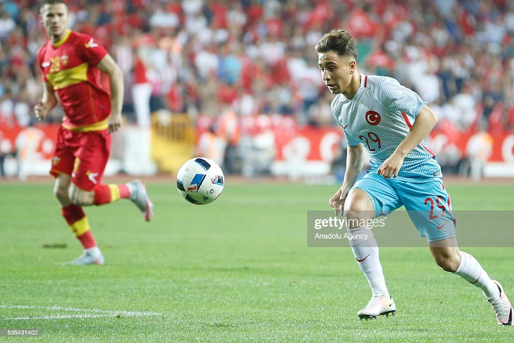 Emre Mor (R) of Turkey vies for the ball during the friendly football match between Turkey and Montenegro at Antalya Ataturk Stadium in Antalya, Turkey on May 29, 2016.