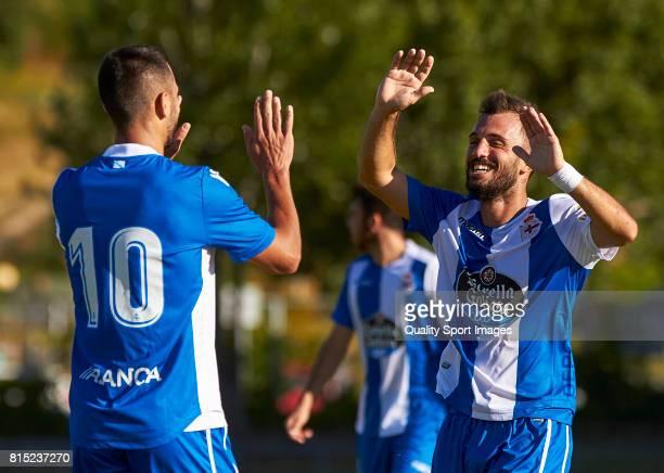 Emre Çolak and Florin Andone of Deportivo de La Coruna celebrate a goal during the preseason friendly match between Club Silva SD and Deportivo de La...