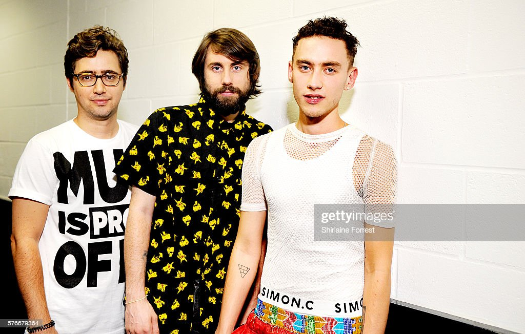 Emre Turkmen Mikey Goldsworthy and Olly Alexander of Years and Years pose backstage before performing at Key 103 Live at Manchester Arena on July 16...
