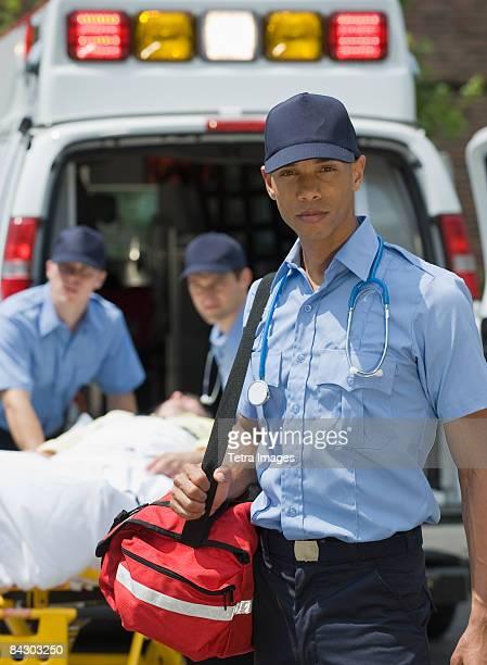 EMTs loading patient into ambulance
