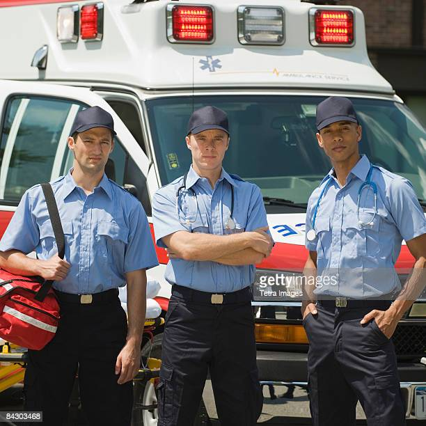 EMTs posing in front of ambulance
