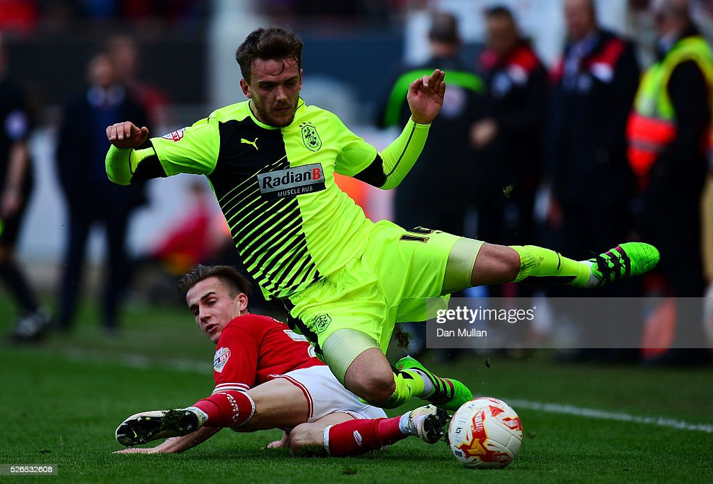 Emyr Huws of Huddersfield Town is tackled by Joe Bryan of Bristol City during the Sky Bet Championship match between Bristol City and Huddersfield Town at Ashton Gate on April 30, 2016 in Bristol, England.