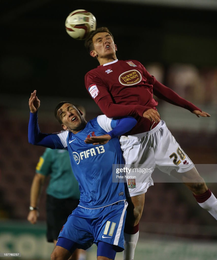 Emyr Huws of Northampton Town challenges for the ball with Jimmy Smith of Leyton Orient during the Johnstone's Paint Trophy Quarter Final match between Northampton Town and Leyton Orient at Sixfields Stadium on December 5, 2012 in Northampton, England.