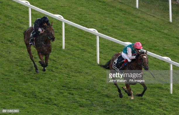Enable ridden by jockey Frankie Dettori on the way to winning the Investec Oaks on Ladies Day during the 2017 Investec Epsom Derby Festival at Epsom...