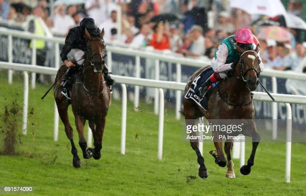 Enable ridden by jockey Frankie Dettori win the Investec Oaks on Ladies Day during the 2017 Investec Epsom Derby Festival at Epsom Racecourse Epsom