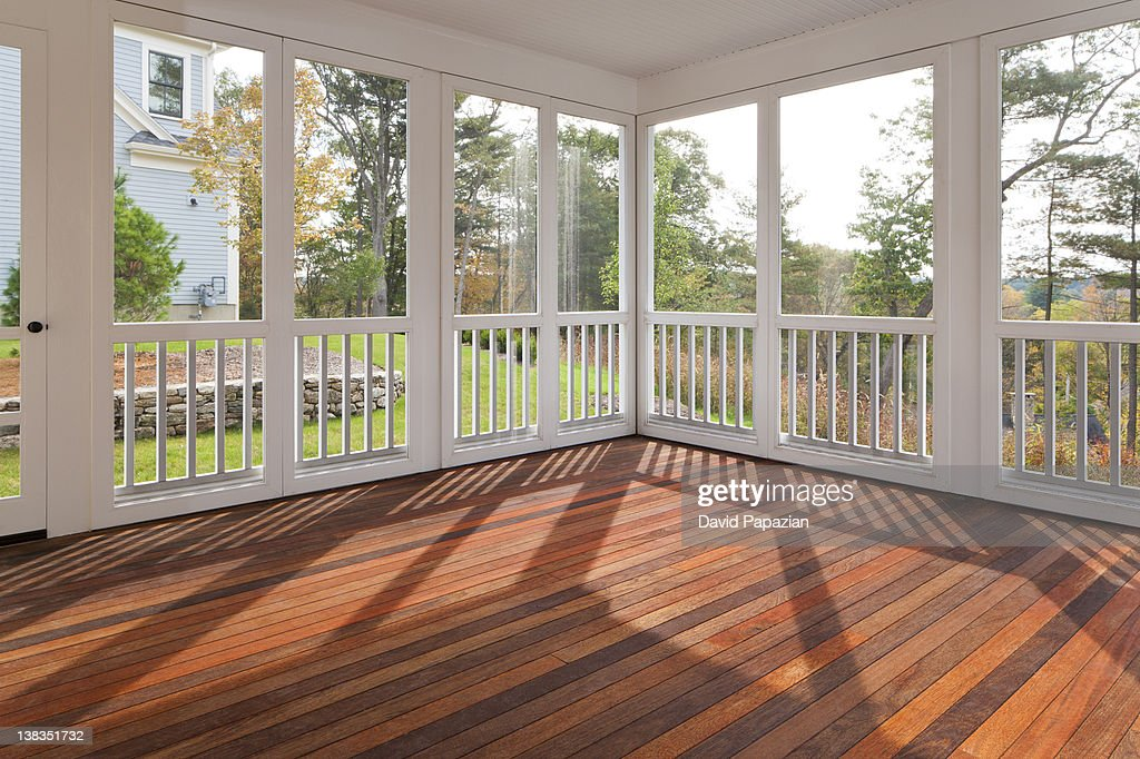 Enclosed outdoor residential deck with hardwood. : Stock Photo