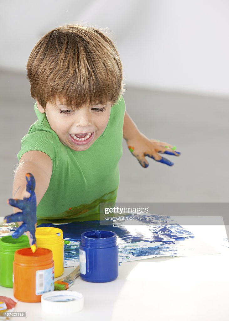 Encouraging the young painter : Stock Photo