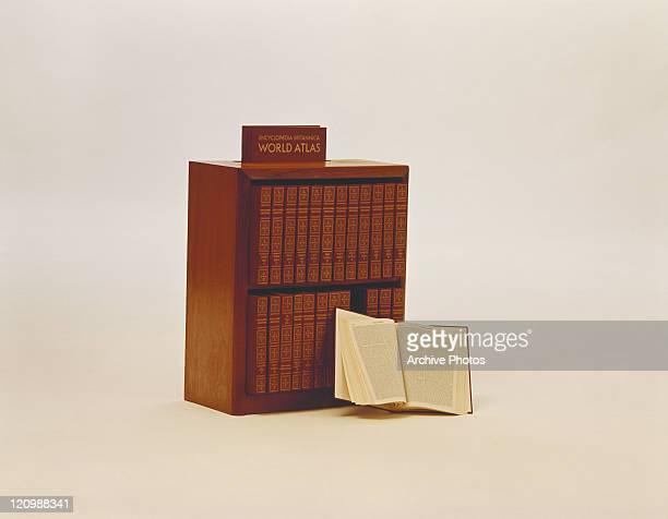 Encyclopaedia bookshelf against white background