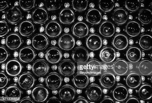 End view of vintage sparkling wine bottle stack