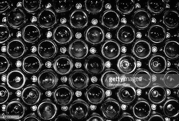 End view of vintage sparkling wine bottle stack